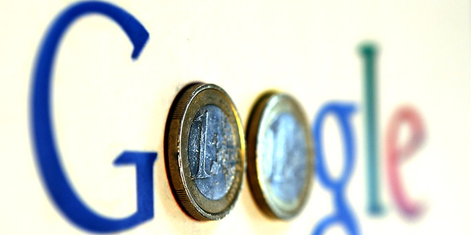 File photograph of an illustration picture showing a Google logo with two one Euro coins