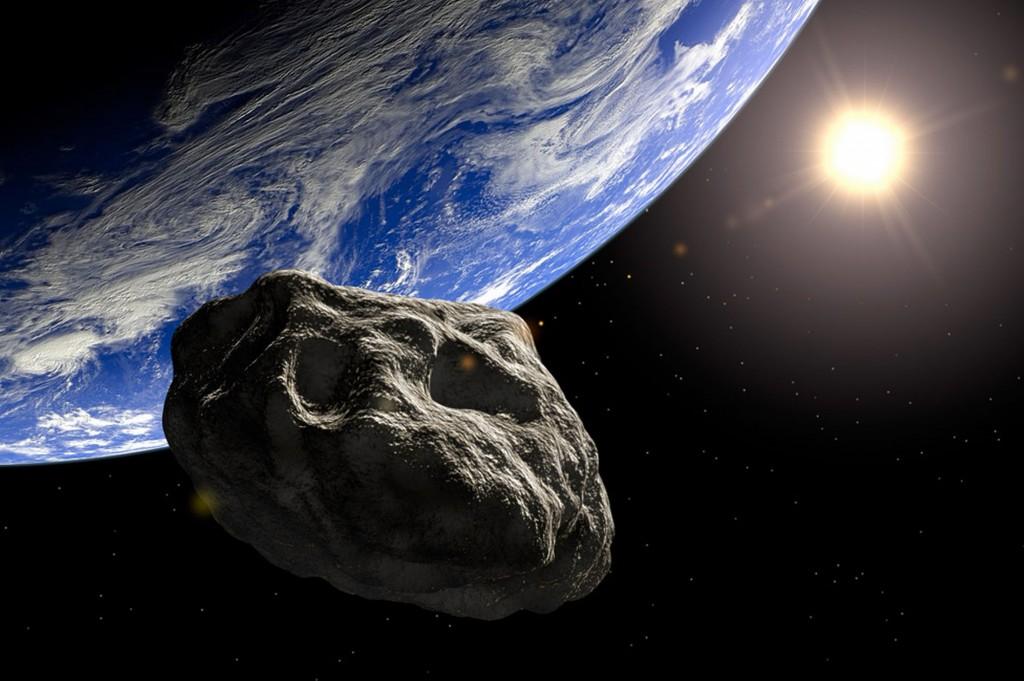 Symbolbild: die Erde und ein Asteroid.